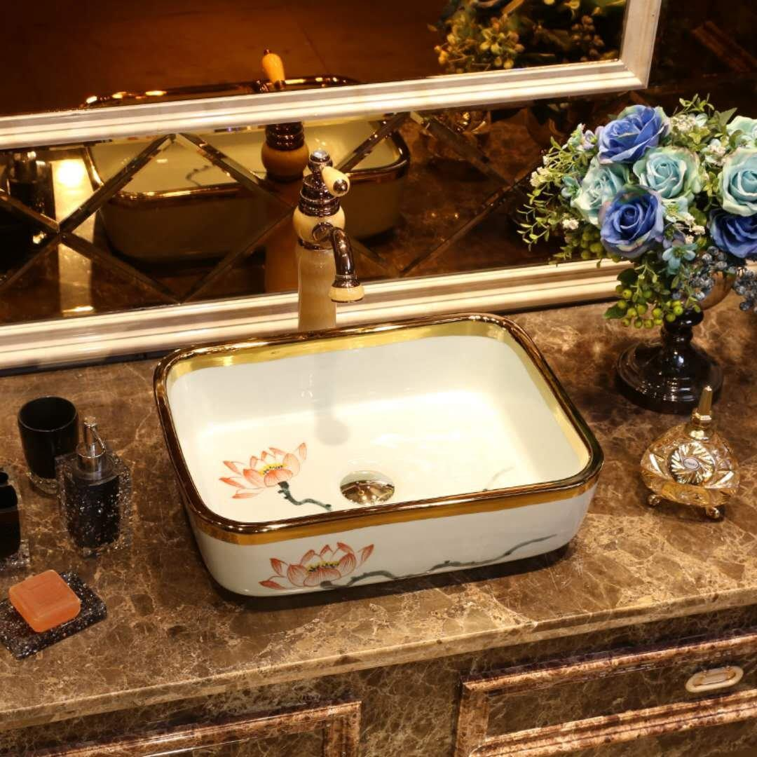 Golden edge above counter bathroom sink basin