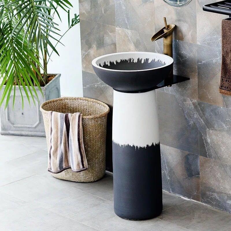 Bathroom pedestal basins in industrial style
