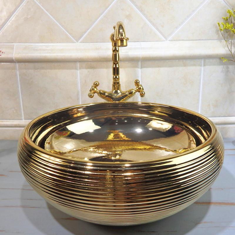 luxury high quality bathroom ceramic sink shinning gold wash hand basin